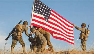 Soldiers planting American Flag