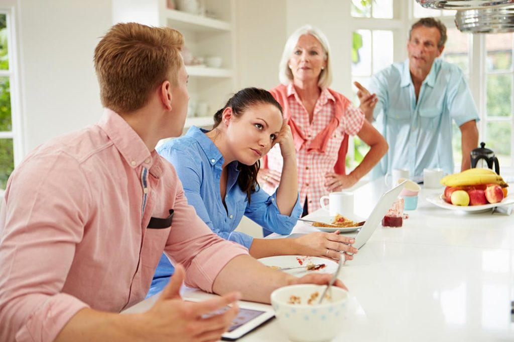 Family With Adult Children Having Argument At Breakfast